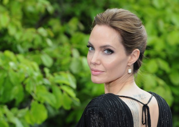 """LONDON, ENGLAND - MAY 08: Angelina Jolie attends a private reception as costumes and props from Disney's """"Maleficent"""" are exhibited in support of Great Ormond Street Hospital at Kensington Palace on May 8, 2014 in London, England. (Photo by Eamonn M. McCormack/Getty Images)"""